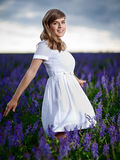 Lady in a field Royalty Free Stock Photo