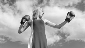 Lady fighter defend her point. Satisfied free girl boxing gloves. Femininity and strength balance. Woman red dress and. Boxing gloves enjoy victory. She fighter royalty free stock photos
