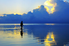 Lady figure. Picture of a lady figure with sunset background at maldives Royalty Free Stock Photography