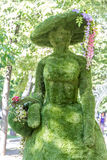 Lady figure made of trimmed bush on natural background Stock Photo