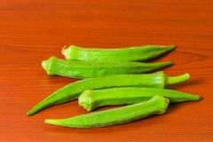 Lady finger okra closeup on isolated background. Lady finger okra vegetables food green fresh organic closeup on isolated background stock photos