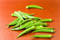 Lady finger okra closeup on isolated background. Lady finger okra vegetables food green fresh organic closeup on isolated background stock images