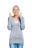 Lady with fingers crossed Stock Image