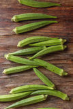 Lady Fingers or Okra over wooden table background. r Top view Royalty Free Stock Photo