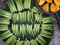 Lady Fingers and Squash. Photo of lady fingers and sliced squash sold at a sidewalk by a street vendor Stock Photos