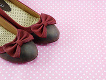 Lady flat shoes decoration with bow on pink background Stock Photo