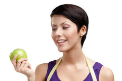 Lady with flexible ruler and green apple Royalty Free Stock Photos