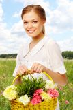 Lady with flowers Stock Photos