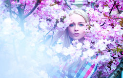 Lady with flowers looking at camera. Spring time Royalty Free Stock Image