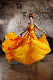 Lady in flying silk dress Stock Photos