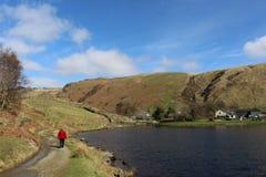 Lady on footpath by Watendlath Tarn, Cumbria Stock Image