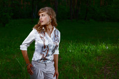 Lady in Forest. Young pretty lady lost in a green forest Royalty Free Stock Photo