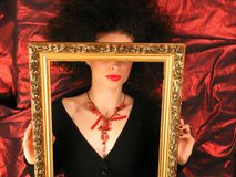 Lady with frame on red. Lady With MakeUp and Frame stock photo
