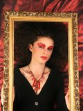 Lady with frame on red. Lady With MakeUp and Frame Royalty Free Stock Photo