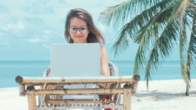 Lady freelancer working on the beach. stock footage