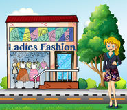 A lady in front of the ladies fashion store Stock Photo