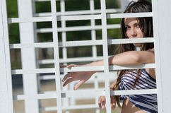 Lady front of pergola wearing cloth black short Stock Photo
