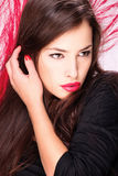 Lady in front of red feather Royalty Free Stock Image