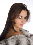 Lady in fur. Closeup portrait of a beautiful young woman in (fake) fur royalty free stock photo