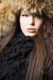 Lady in fur cap Royalty Free Stock Images