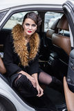 The lady in fur in the car. Royalty Free Stock Image