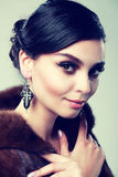 Lady in a fur coat Stock Photos