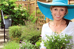 Lady gardener in the garden. Royalty Free Stock Photos