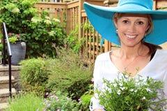 Lady gardener in the garden. Royalty Free Stock Photos