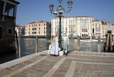 The lady and gentleman pose in a silver costume Venice Carnival 2019. The lady and gentleman pose in a silver costume Carnival Venice 2019 stock photography