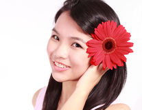 Lady with gerbera flower. Beautiful young lady with gerbera flower isolated on white background Stock Photos