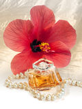 Lady gift perfume, pearl necklace and hibiscus Stock Photo