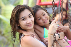 Lady And Girl In A Swing Royalty Free Stock Photos