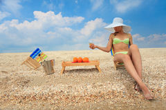 Lady with glass of champagne on beach Stock Photography