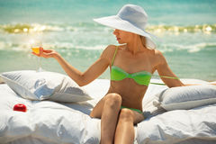 Lady with glass of champagne on beach Royalty Free Stock Photography
