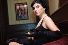 Lady with the glass of cognac. stock photo