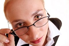 Lady and Glasses. Woman looking over glasses Royalty Free Stock Photo