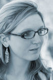Lady with glasses. Young lady wearing glasses (blue toned Royalty Free Stock Photography