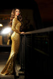 Lady in golden shining dress Royalty Free Stock Image