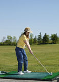 Lady At Golf Driving Range Stock Photo