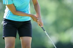 Lady golf putting Stock Images