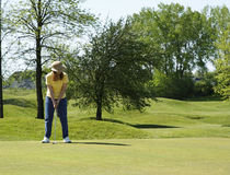 Lady On Golf Putting Green Royalty Free Stock Photo