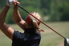 Lady golf swing Royalty Free Stock Photography