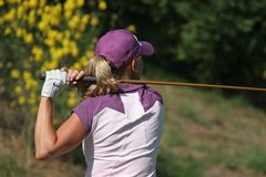 Lady golf swing Stock Photography