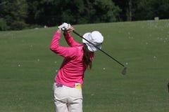 Lady golf swing. On Leman lake Stock Image
