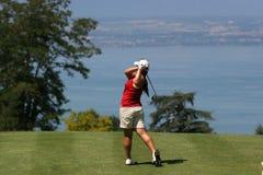 Lady golf swing at Leman lake. Lady golf swing over the Leman lake Stock Photography