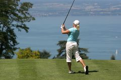 Lady golf swing at Leman lake Royalty Free Stock Photo
