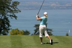 Lady golf swing at Leman lake. Lady golf swing over the Leman lake Royalty Free Stock Photo
