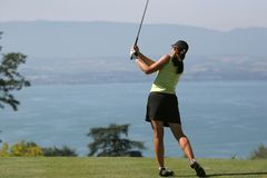 Lady golf swing at Leman lake Stock Images
