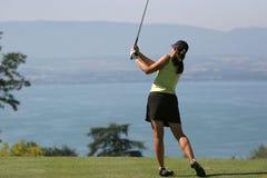 Lady golf swing at Leman lake. Lady golf swing on Leman lake Stock Images