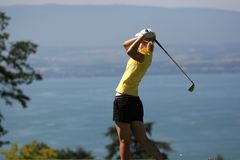 Lady golf swing at Leman lake Royalty Free Stock Image